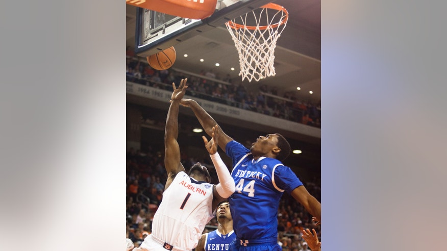 Kentucky's Dakari Johnson (44) blocks Auburn's KT Harrell (1) during an NCAA college basketball game on Wednesday, Feb. 12, 2014, in Auburn, Ala. Kentucky defeated Auburn 64-56. (AP Photo/The Opelika-Auburn News, Albert Cesare)