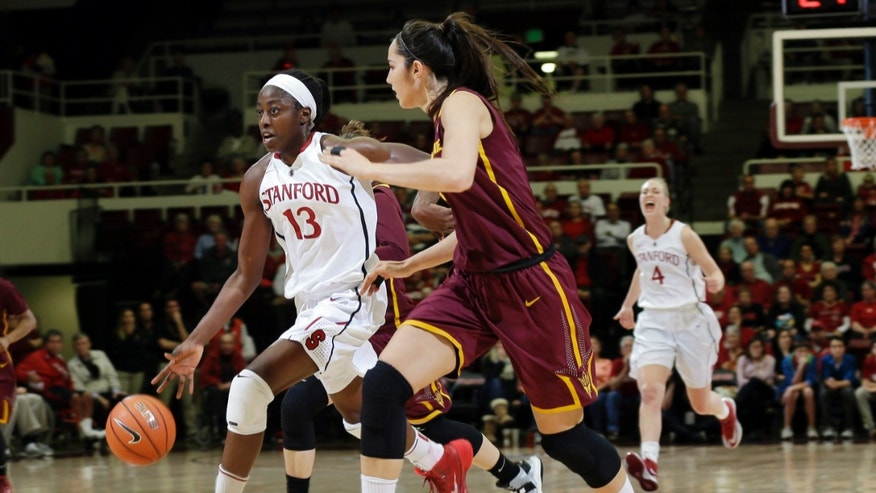 Stanford forward Chiney Ogwumike (13) dribbles next to Arizona State center Joy Burke during the first half of an NCAA college basketball game Friday, Feb. 14, 2014, in Stanford, Calif. (AP Photo/Marcio Jose Sanchez)
