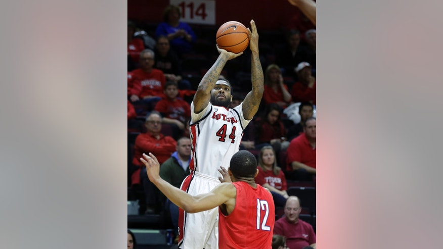 Rutgers forward J.J. Moore (44) shoots past SMU guard Nick Russell (12) during the second half of an NCAA college basketball game on Friday, Feb. 14, 2014, in Piscataway, N.J. (AP Photo/Mel Evans)