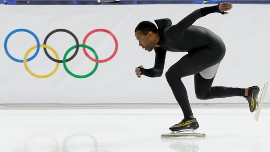 Feb. 14, 2014: Shani Davis of the U.S. skates in the prototype of the official US Speedskating suit during a training session at the Adler Arena Skating Center at the 2014 Winter Olympics in Sochi, Russia.