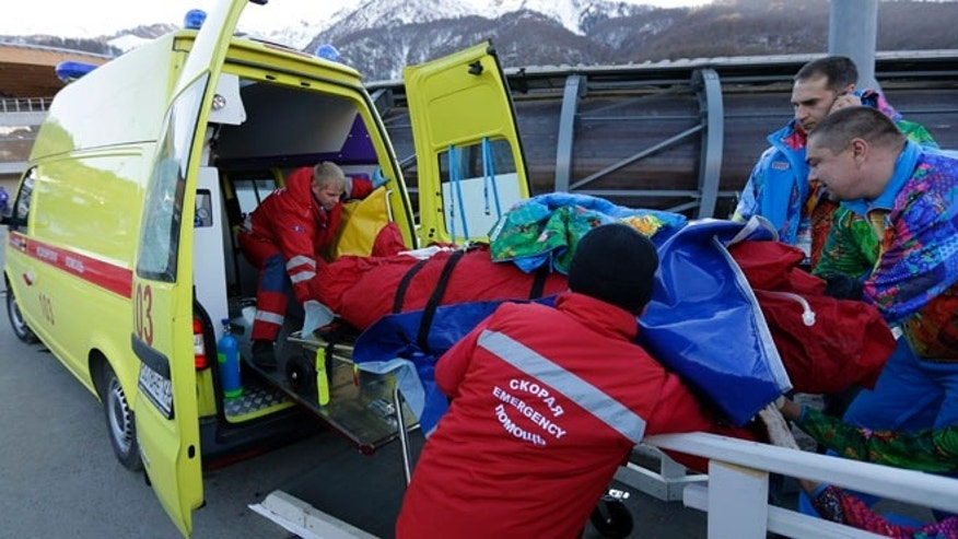 Feb. 13, 2014: A track worker is loaded into an ambulance after he was injured when a forerunner bobsled hit him just before the start of the men's two-man bobsled training at the 2014 Winter Olympics in Krasnaya Polyana, Russia.