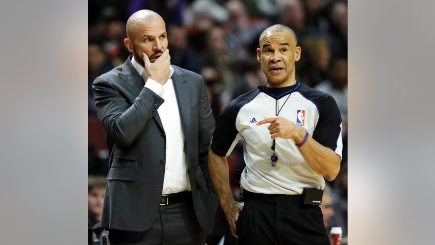 Brooklyn Nets head coach Jason Kidd, left, reacts as he listens to official Danny Crawford during the first half of an NBA basketball game against the Chicago Bulls in Chicago on Thursday, Feb. 13, 2014. (AP Photo/Nam Y. Huh)