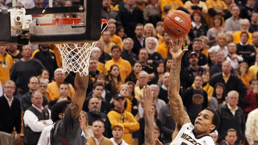 Missouri guard Jabari Brown takes the game-winning shot in the second half of an NCAA college basketball game against Arkansas on Thursday, Feb. 13, 2014, in Columbia, Mo. (AP Photo/St. Louis Post-Dispatch, Chris Lee)