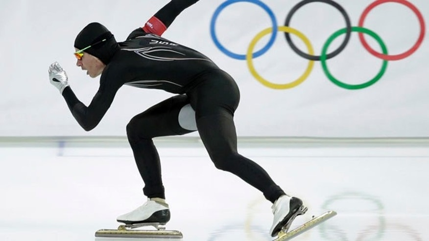 Feb. 10, 2014: In this file photo, Tucker Fredricks of the United States competes in the first heat of the men's 500-meter speedskating race at Adler Arena in Sochi, Russia, during the 2014 Winter Olympics. After a strong season on the World Cup circuit, the U.S. speedskating team has had a miserable performance the first week of the Sochi Olympics  and much of the speculation has turned to its new high-tech Under Armour skinsuit developed with help from aerospace and defense giant Lockheed Martin.