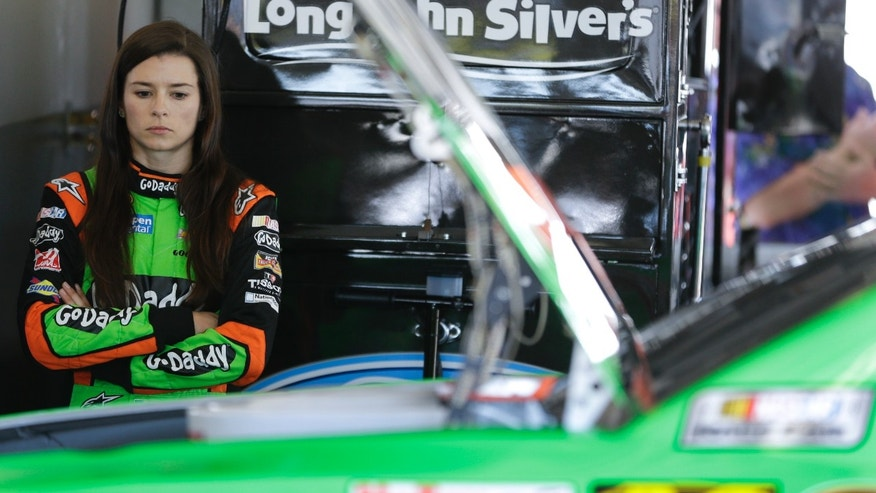 Driver Danica Patrick stands by her car as her crew makes adjustment during a practice for the NASCAR Daytona 500 auto race at Daytona International Speedway in Daytona Beach, Fla., Saturday, Feb. 15, 2014. (AP Photo/John Raoux)