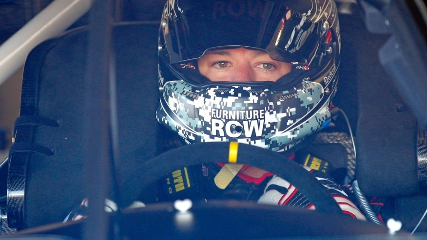 Driver Martin Truex Jr. gets ready to go out on the track to practice for the NASCAR Daytona 500 auto race at Daytona International Speedway in Daytona Beach, Fla., Saturday, Feb. 15, 2014. (AP Photo/Terry Renna)