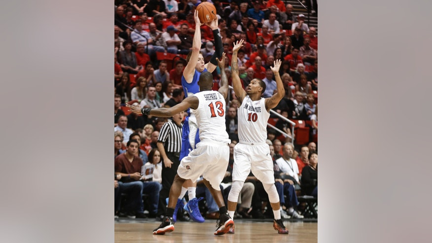 Air Force guard Max Yon gets off a pass, trying to break the press of San Diego State's Winston Shepard, left, and Aqeel Quinn during the first half of an NCAA college basketball game Saturday, Feb. 15, 2014, in San Diego. (AP Photo/Lenny Ignelzi)