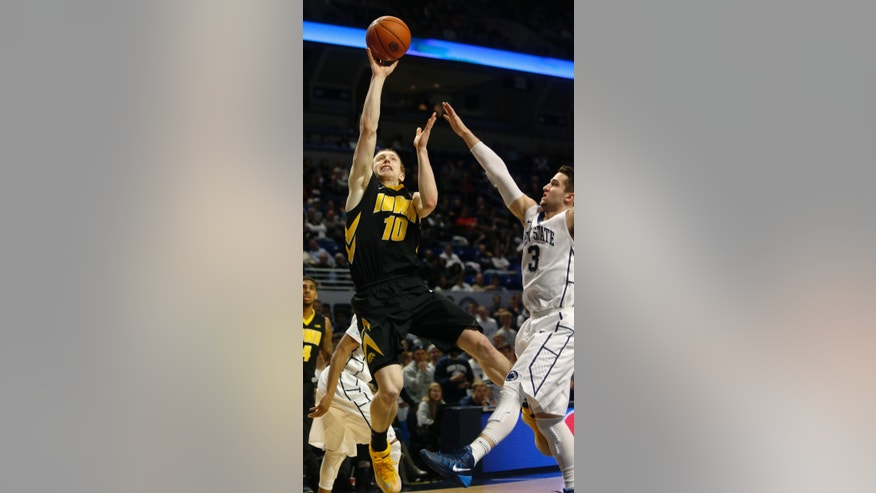 Iowa's Mike Gesell (10) shoots in front of Penn State's Graham Woodward (3) during the first half of an NCAA college basketball game on Saturday, Feb. 15, 2014, in State College. Iowa won 82-70. (AP Photo/Keith Srakocic)