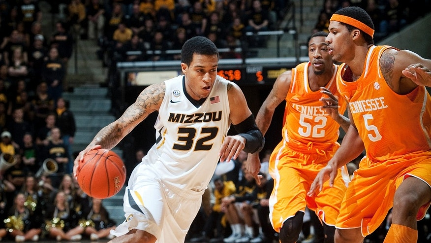 Missouri's Jabari Brown, left, dribbles around Tennessee's Jamell Stokes, right, and Jordan McRae during the first half of an NCAA college basketball game Saturday, Feb. 15, 2014, in Columbia, Mo. (AP Photo/L.G. Patterson)