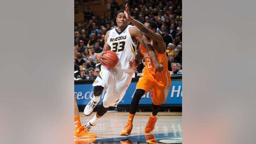 Missouri's Earnest Ross, left, dribbles around Tennessee's Antonio Barton as he heads toward the basket during the first half of an NCAA college basketball game Saturday, Feb. 15, 2014, in Columbia, Mo. (AP Photo/L.G. Patterson)