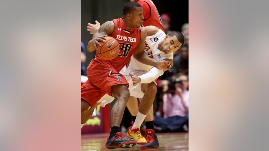Iowa State guard Naz Long takes a swipe at the ball as Texas Tech guard Toddrick Gotcher tries to get past him during the first half of an NCAA college basketball game at Hilton Coliseum in Ames, Iowa, Saturday, Feb. 15, 2014. (AP Photo/Justin Hayworth)
