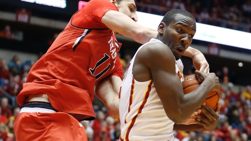 Texas Tech forward Dejan Kravic reaches over the back of Iowa State forward Dustin Hogue as he grabs a rebound during the first half of an NCAA college basketball game at Hilton Coliseum in Ames, Iowa, Saturday, Feb. 15, 2014. (AP Photo/Justin Hayworth)