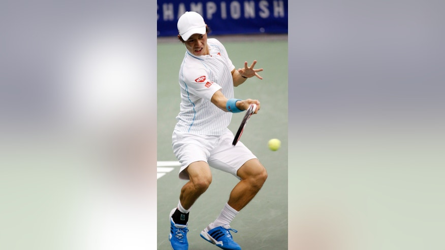 Kei Nishikori, of Japan, hits a return to Michael Russell in the semifinal match at the U.S. National Indoor Tennis Championships on Saturday, Feb. 15, 2014, in Memphis, Tenn. (AP Photo/Rogelio V. Solis)