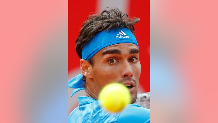 Italy's Fabio Fognini eyes the ball during a Buenos Aires' Copa Claro Open tennis semifinal match against Spain's Tommy Robredo in Buenos Aires, Argentina, Saturday, Feb. 15, 2014. (AP Photo/Victor R. Caivano)