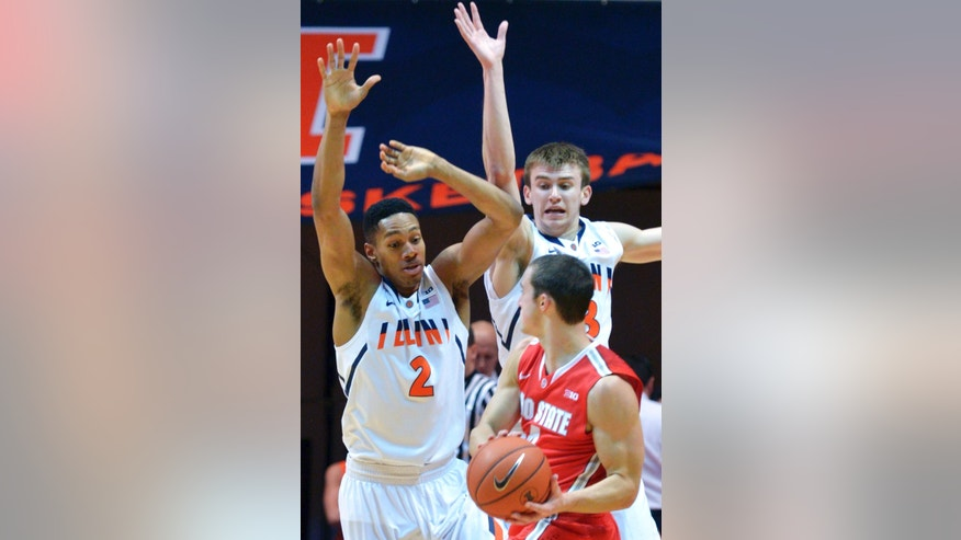 Illinois' Joseph Bertrand (2) and Illinois' Jon Ekey, back right, defend Ohio State's guard Aaron Craft during the first half of an NCAA college basketball game in Champaign, Ill., on Saturday, Feb. 15, 2014. (AP Photo/Robin Scholz)