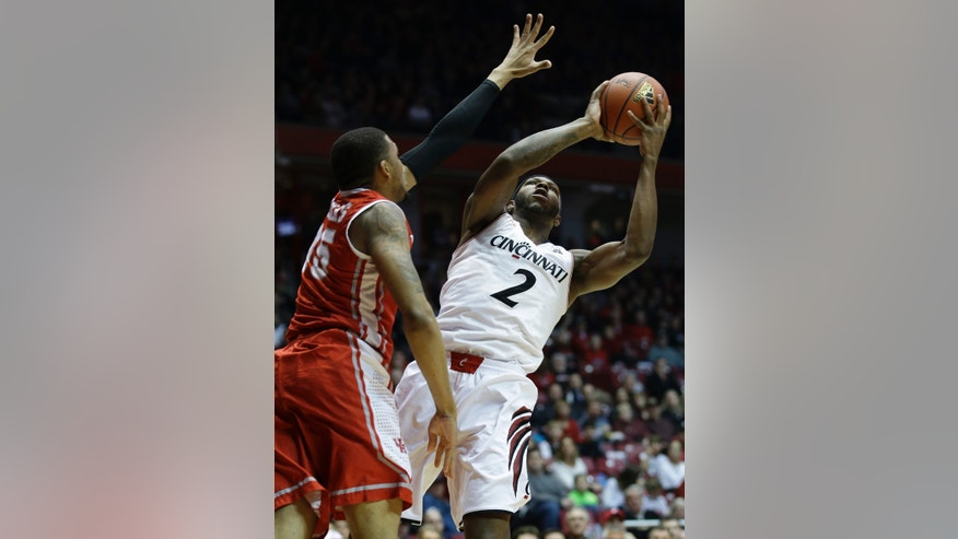Cincinnati forward Titus Rubles (2) shoots against Houston forward TaShawn Thomas during the first half of an NCAA college basketball game, Saturday, Feb. 15, 2014, in Cincinnati. (AP Photo/Al Behrman)