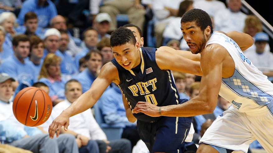 North Carolina's James Michael McAdoo (43) battles with Pittsburgh's James Robinson (0) during the first half of an NCAA college basketball game in Chapel Hill, N.C., Saturday, Feb. 15, 2014. (AP Photo/Karl B DeBlaker)