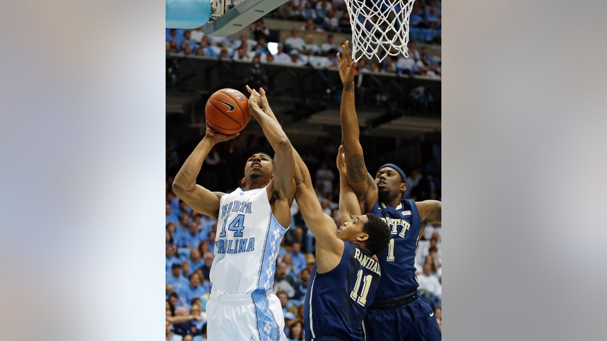 North Carolina's Desmond Hubert (14) struggles under the basket with Pittsburgh's Derrick Randall (11) and Jamel Artis (1) during the first half of an NCAA college basketball game in Chapel Hill, N.C., Saturday, Feb. 15, 2014. (AP Photo/Karl B DeBlaker)