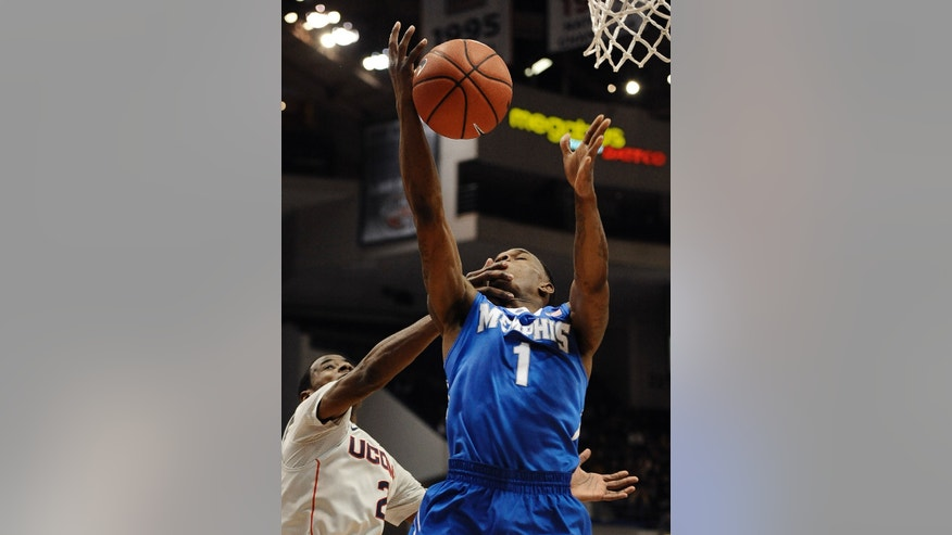 Connecticut's DeAndre Daniels, left, fouls, Memphis' Joe Jackson, right, during the first half of an NCAA college basketball game, Saturday, Feb. 15, 2014, in Hartford, Conn. (AP Photo/Jessica Hill)