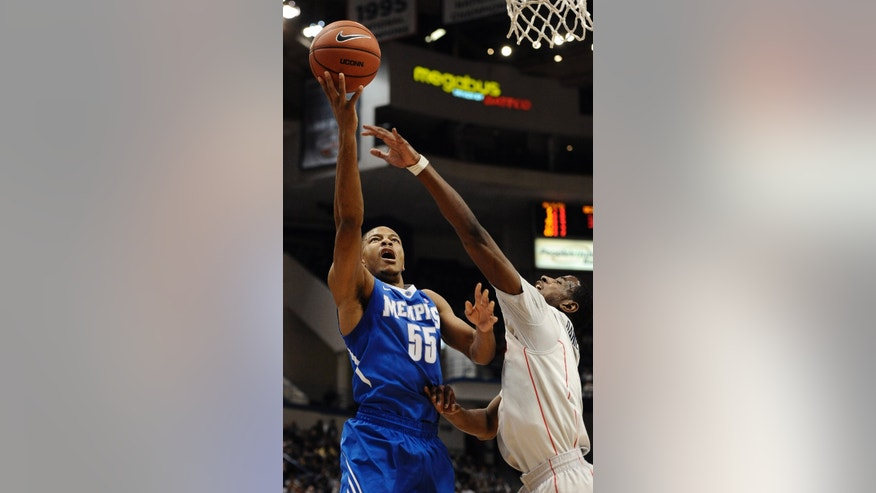 Memphis' Geron Johnson goes up for a basket as Connecticut's DeAndre Daniels, right, defend during the first half of an NCAA college basketball game, Saturday, Feb. 15, 2014, in Hartford, Conn. (AP Photo/Jessica Hill)