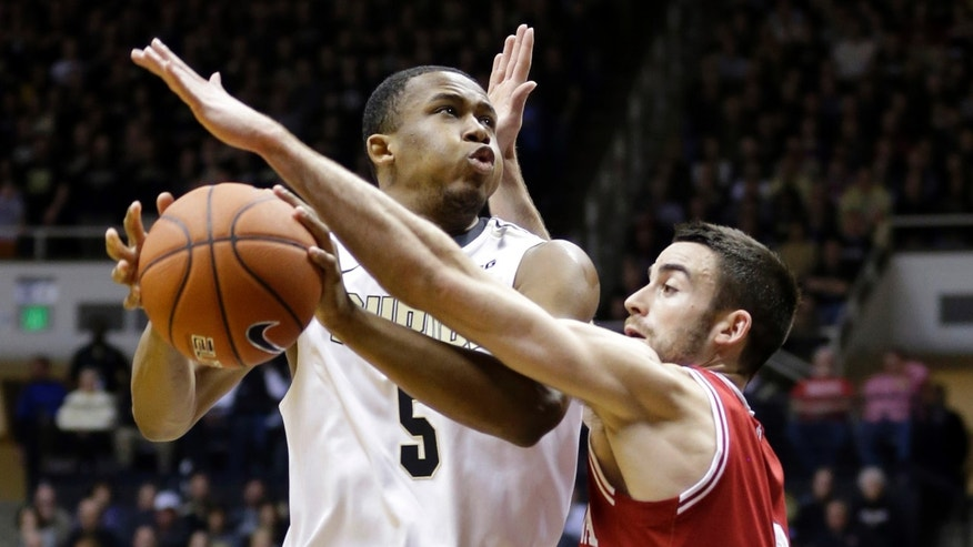 Indiana forward Will Sheehey, right, fouls Purdue forward Basil Smotherman in the first half of an NCAA college basketball game in West Lafayette, Ind., Saturday, Feb. 15, 2014. (AP Photo/Michael Conroy)