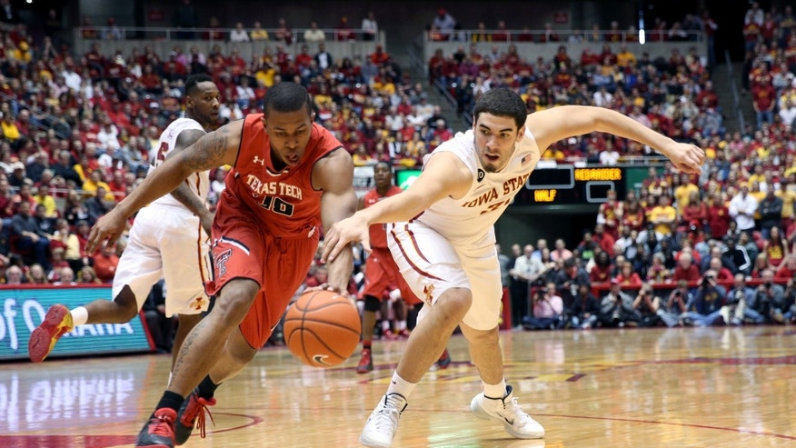 Texas Tech guard Toddrick Gotcher and Iowa State forward Georges Niang chase a loose ball during the second half of an NCAA college basketball game at Hilton Coliseum in Ames, Iowa, Saturday, Feb. 15, 2014. Iowa State won 70-64. (AP Photo/Justin Hayworth)