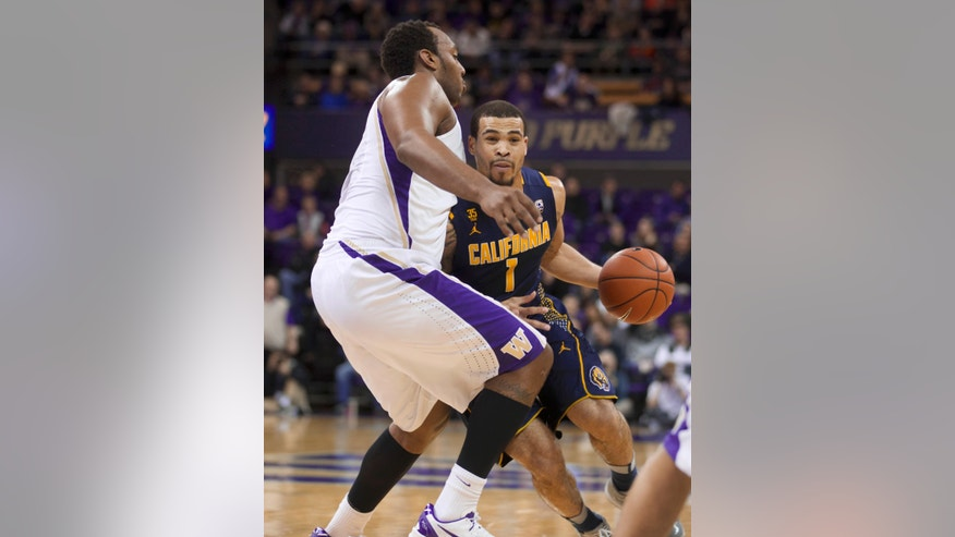 California's Justin Cobbs drives to the basket while Washington's Perris Blackwell defends during the first half of an NCAA college basketball game Saturday, Feb. 15, 2014, in Seattle. (AP Photo/Stephen Brashear)