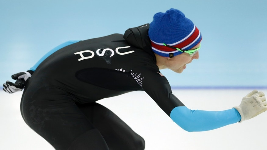 Feb. 15, 2014: U.S. Speedskater Jonathan Kuck warms-up wearing the old World Cup race suit, prior to the men's 1,500-meter race at the Adler Arena Skating Center during the 2014 Winter Olympics in Sochi, Russia.