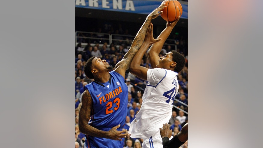 Kentucky's Dakari Johnson, right, shoots as Florida's Chris Walker defends during the first half of an NCAA college basketball game on Saturday, Feb. 15, 2014, in Lexington, Ky. (AP Photo/James Crisp)