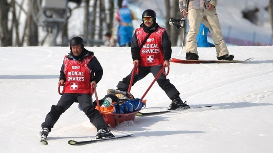 Feb. 16, 2014: Jacqueline Hernandez of the United States is carried off the course in a stretcher after crashing in a seeding run during women's snowboard cross competition at the Rosa Khutor Extreme Park, at the 2014 Winter Olympics.