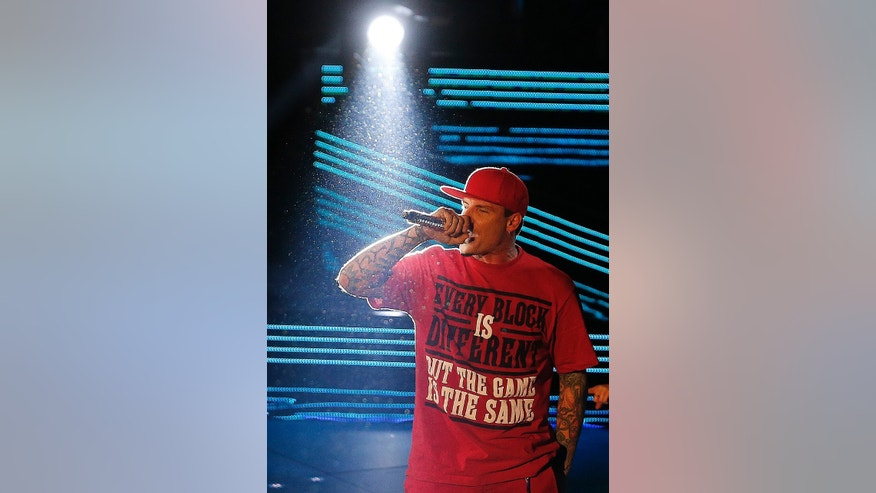 Singer Vanilla Ice performs during the skills competition at the NBA All Star basketball game, Saturday, Feb. 15, 2014, in New Orleans. (AP Photo/Bill Haber)