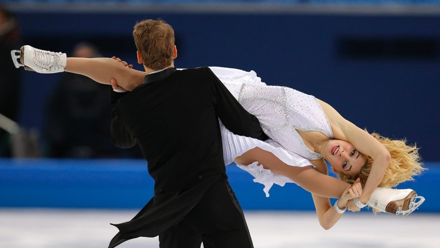 Isabella Tobias and Deividas Stagniunas of Lithuania compete in the ice dance short dance figure skating competition at the Iceberg Skating Palace during the 2014 Winter Olympics, Sunday, Feb. 16, 2014, in Sochi, Russia. (AP Photo/Vadim Ghirda)