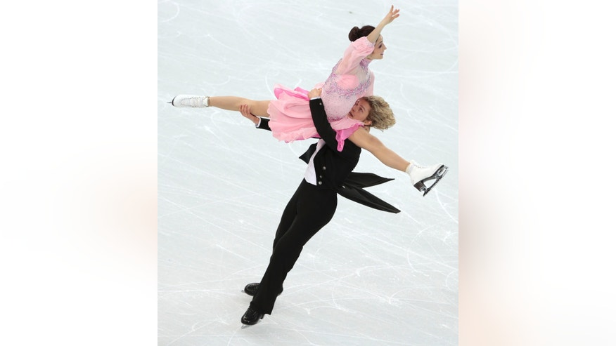 Meryl Davis and Charlie White of the United States compete in the ice dance short dance figure skating competition at the Iceberg Skating Palace during the 2014 Winter Olympics, Sunday, Feb. 16, 2014, in Sochi, Russia. (AP Photo/Ivan Sekretarev)