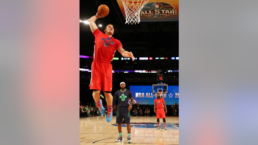 West Team's Blake Griffin, of the Los Angeles Clippers (32) heads to the hoop as East Team's LeBron James, of the Miami Heat (6) looks on during the NBA All Star basketball game, Sunday, Feb. 16, 2014, in New Orleans. (AP Photo/Christian Petersen, Pool)