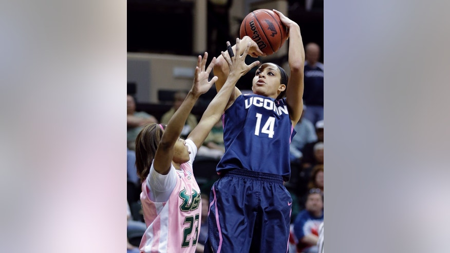 Connecticut guard Bria Hartley (14) shoots over South Florida guard Shalethia Stringfield (23) during the first half of an NCAA women's college basketball game, Sunday, Feb. 16, 2014, in Tampa, Fla. (AP Photo/Chris O'Meara)