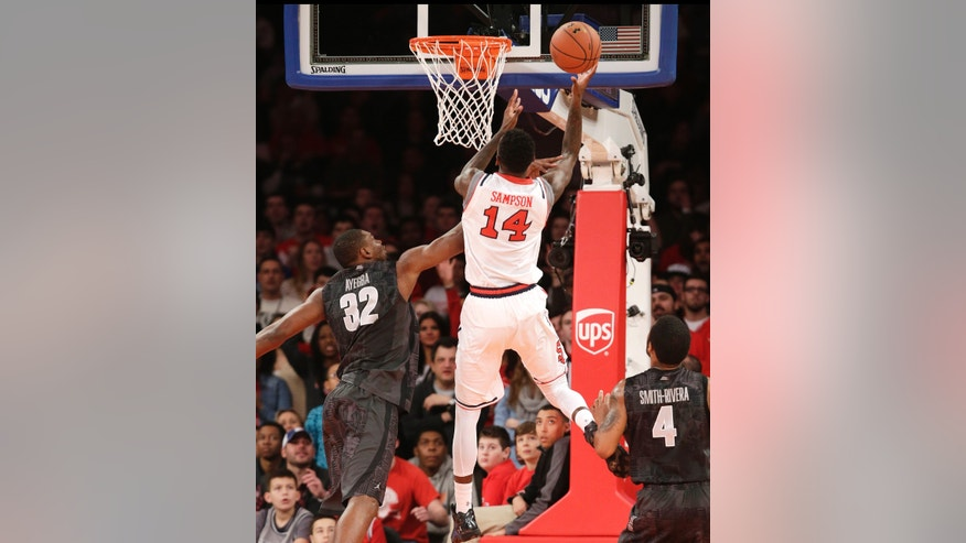 St. John's forward Jakarr Sampson (14) shoots over Georgetown center Moses Ayegba (32) during the first half of an NCAA college basketball game at Madison Square Garden in New York, Sunday, Feb. 16, 2014.  (AP Photo/Kathy Willens)