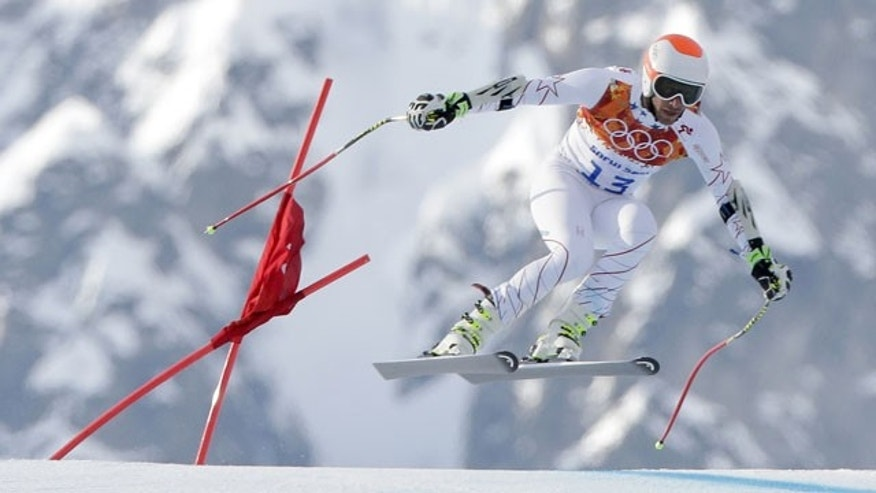 February 16, 2014: Joint bronze medal winner Bode Miller of the United States makes a jump in the men's super-G at the Sochi 2014 Winter Olympics in Krasnaya Polyana, Russia. (AP Photo/Charlie Riedel)