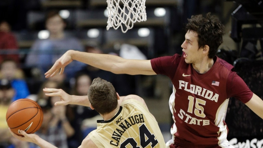 Florida State's Boris Bojanovsky (15) blocks a shot by Wake Forest's Tyler Cavanaugh (34) during the second half of an NCAA college basketball game in Winston-Salem, N.C., Saturday, Feb. 15, 2014. Florida State won 67-60. (AP Photo/Chuck Burton)