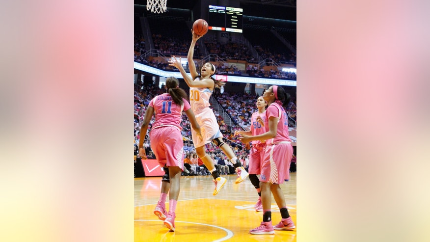 Tennessee center Isabelle Harrison (20) shoots over Kentucky forward DeNesha Stallworth (11) as forward/center Azia Bishop (50) and guard Bria Goss (13) look on in the first half of an NCAA college basketball game on Sunday, Feb. 16, 2014, in Knoxville, Tenn. (AP Photo/Wade Payne)