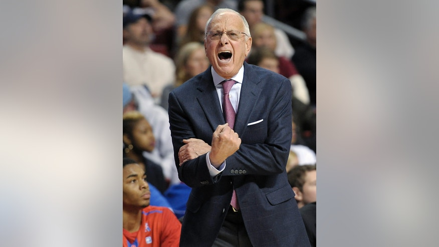 Southern Methodist coach Larry Brown reacts to an official's call during the first half of an NCAA college basketball game against Temple, Sunday, Feb. 16, 2014, in Philadelphia. (AP Photo/Michael Perez)