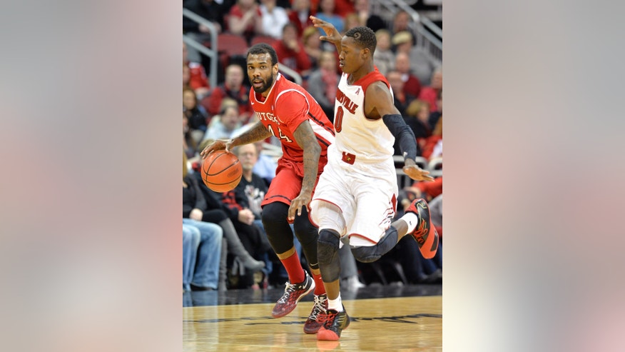 Rutgers' J.J. Moore, left, attempts to drive around the defense of Louisville's Terry Rozier during the first half of an NCAA college basketball game on Sunday, Feb. 16, 2014, in Louisville, Ky. (AP Photo/Timothy D. Easley)