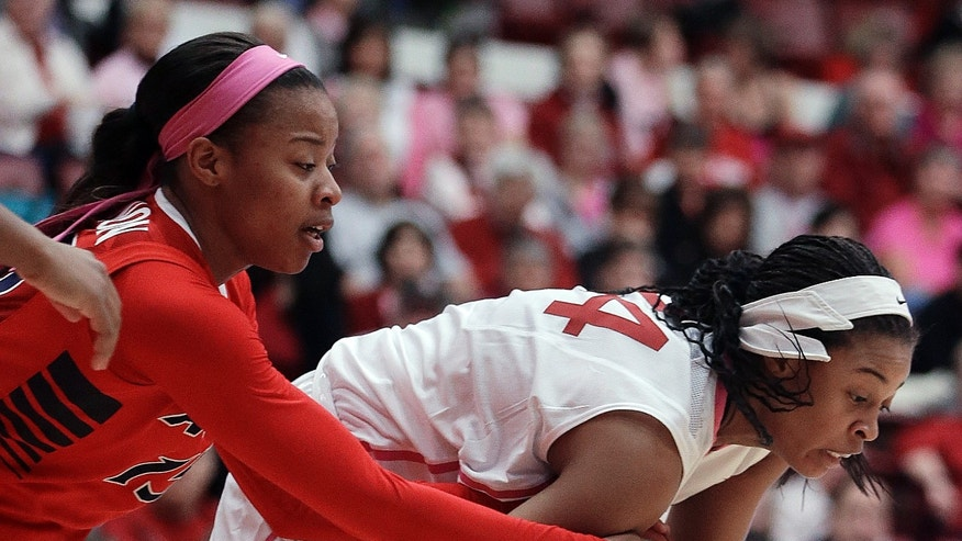 Stanford's Erica McCall, right, keeps the ball from Arizona's Keyahndra Cannon during the first half of an NCAA college basketball game, Sunday, Feb. 16, 2014, in Stanford, Calif. (AP Photo/Ben Margot)