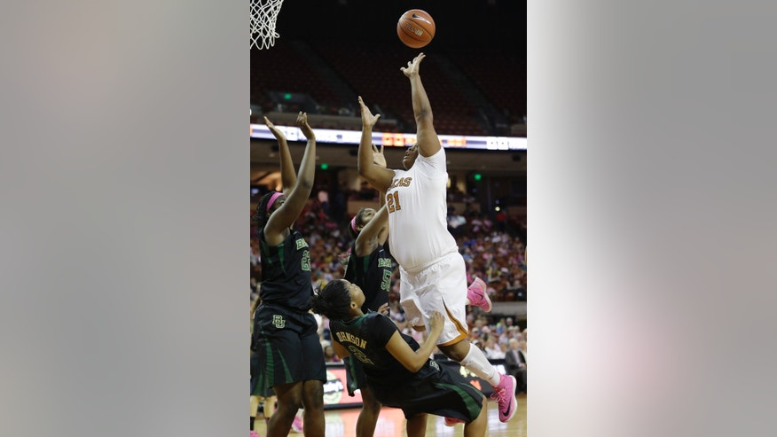 Texas' Nekia Jones (21) shoots over Baylor's Niya Johnson (2) during the first half of an NCAA college basketball game on Sunday,  Feb. 16, 2014, in Austin, Texas. (AP Photo/Eric Gay)