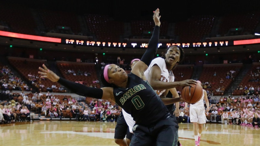 Baylor's Odyssey Sims (0) blocks out Texas' Nneka Enemkpali who tries to shoot during the first half of an NCAA college basketball game on Sunday, Feb. 16, 2014, in Austin, Texas. (AP Photo/Eric Gay)