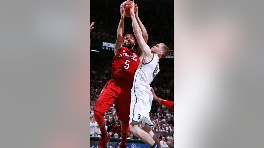 Nebraska's Terran Petteway (5) shoots against Michigan State's Russell Byrd during the first half of an NCAA college basketball game on Sunday, Feb. 16, 2014, in East Lansing, Mich. (AP Photo/Al Goldis)