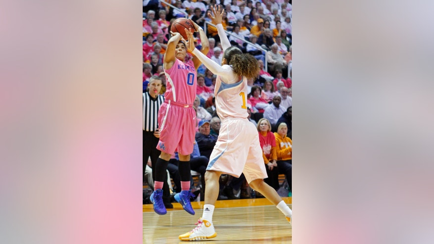 Kentucky guard Jennifer O'Neill (0) shoots over Tennessee guard Meighan Simmons in the second half of an NCAA college basketball game on Sunday, Feb. 16, 2014, in Knoxville, Tenn. Kentucky won 75-71. (AP Photo/Wade Payne)
