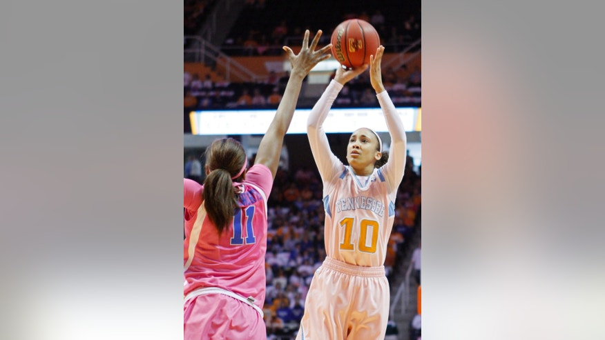 Tennessee guard Meighan Simmons (10) shoots over Kentucky forward DeNesha Stallworth (11) in the first half of an NCAA college basketball game on Sunday, Feb. 16, 2014, in Knoxville, Tenn. (AP Photo/Wade Payne)