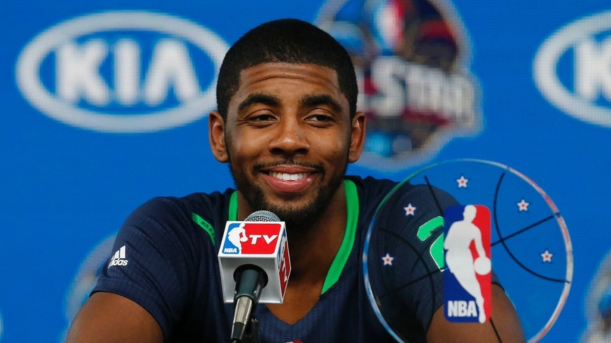 East Team's Kyrie Irving, of the Cleveland Cavaliers speaks during a news conference with his All Star MVP trophy after the NBA All Star basketball game, Sunday, Feb. 16, 2014, in New Orleans. (AP Photo/Bill Haber)