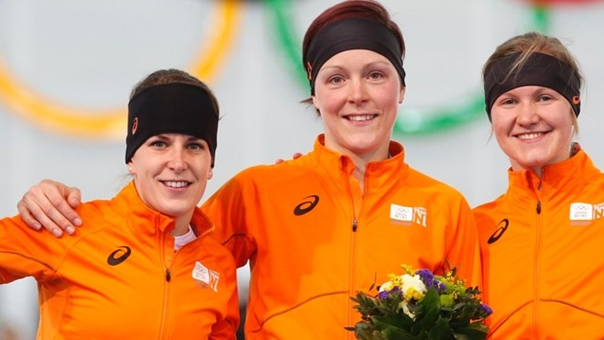 Feb. 16, 2014: Athletes from the Netherlands, from left to right, silver medallist Ireen Wust, Gold medallist Jorien ter Mors and bronze medallist Lotte van Beek celebrate during the flower ceremony for the women's 1,500-meter speedskating race at the Adler Arena Skating Center during the 2014 Winter Olympics in Sochi, Russia.