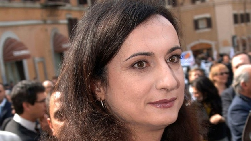 "April 28, 2006: In this file photo, then Italian Communist Refoundation Party lawmaker Vladimir Luxuria, Italy's first transgender lawmaker, arrives at the Lower Chamber in Rome. Italian Daily Corriere della Sera quoted an Italian advocate for gay rights, Imma Battaglia, as saying Luxuria called to say she was arrested by police in Sochi while attending the 2014 Games with a flag with the slogan, in Russian, ""Gay is OK."""